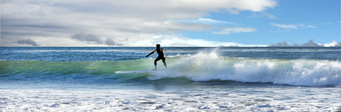 Surfer on the Pacific Coast in California